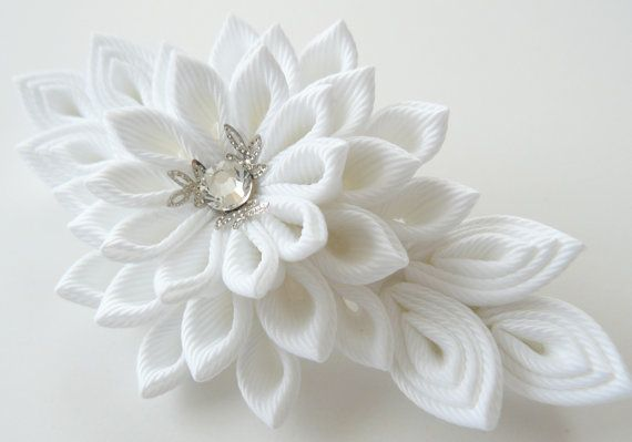 A flower is made in the technique of tsumami kanzashi. Flower is made from grosgrain ribbons. Swarovski crystal. Size ~ 4 1/2 inch (11.5 cm) long x 2 1/2