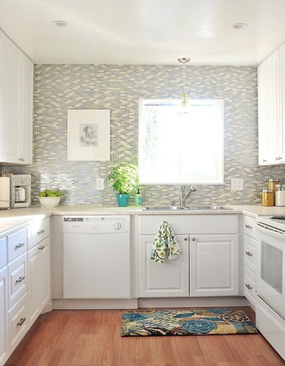 tile in shades of blue, green and cream for feature wall + backsplash