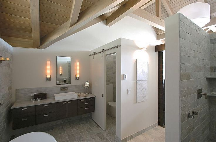 Using-the-sliding-barn-door-for-the-toilet-closet-in-the-master-bathroom. hang door off ceiling slide from toilet to between shower and tub yet narrower then a wall