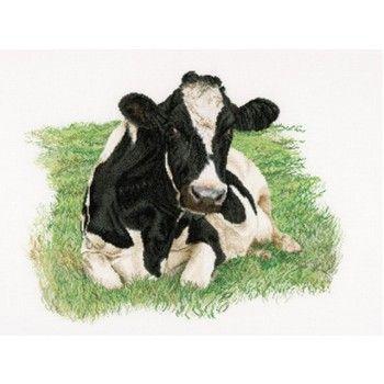 Prachtige gedetailleerd borduurwerk van een liggende koe.