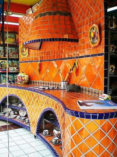 mexican style kitchen -- why are our kitchens so colourless with mostly straight lines? this one really cheers me up.