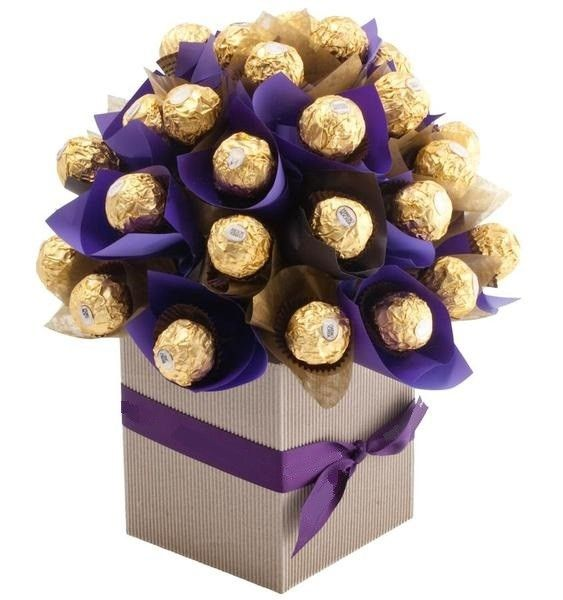 """Sweet Like Chocolate"" Bouquet! You can be sure to sweeten up anyone's day with this delicious and unique chocolate bouquet! Includes 48 Ferrero Rocher chocolates.  The sweetest way to tell someone you love them!   Buy now from www.theperfectgift.ae!   FREE delivery to Dubai within 24-48 hours! #theperfectgift #uae #dubai #chocolates #gift"