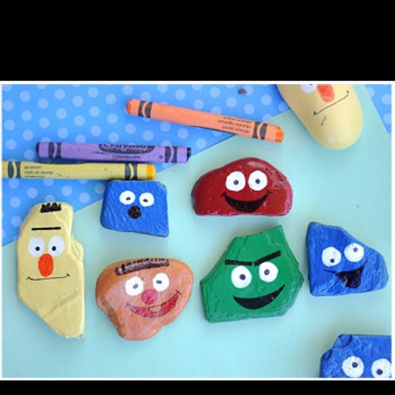Rocks painted as Elmo characters <3