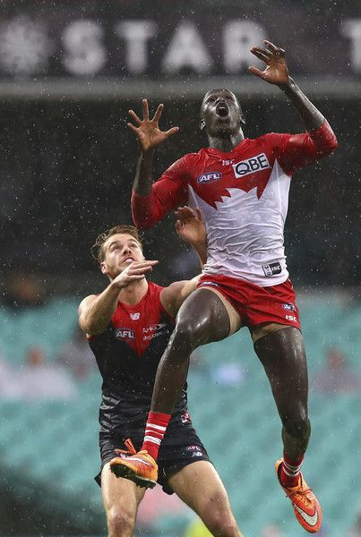 Aliir Aliir of the Swans marks over Jack Watts of the Demons during the round 13 AFL match between the Sydney Swans and the Melbourne Demons at Sydney Cricket Ground on June 19, 2016 in Sydney, Australia.