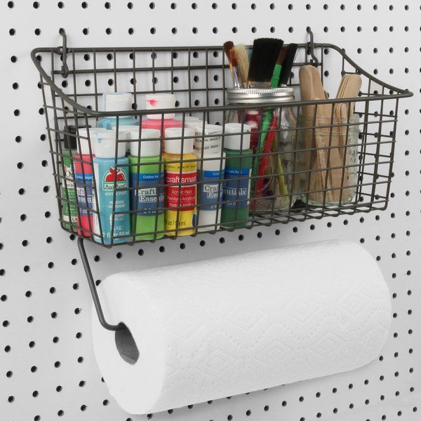 Give your garage, craft room or work space an organized makeover with pegboard. The Pegboard Basket Wall Mounted Paper Towel Holder keeps numerous tools and supplies neatly organized while holding standard and jumbo paper towel rolls. Use the basket to hold spray cans, gardening gloves or small hand tools. Use on standard pegboard, slat wall or mount to walls with included optional hardware. Made of sturdy steel.