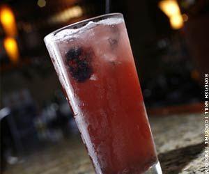 Blackberry Rum Runner  - 1-1/2 oz Mount Gay Eclipse Rum  - 1/2 oz Banana Liqueur  - Splash of pineapple juice  - Splash of orange juice  - 1/2 oz Monin Blackberry Syrup  - 3 fresh blackberries  - Splash of Sprite or club soda
