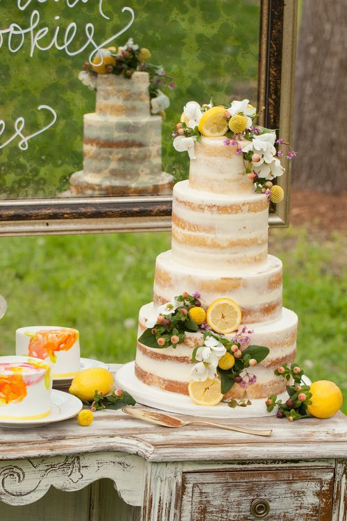 Rustic chic four tier wedding cake with yellow lemon detail; Via Sugarbelle Cakery