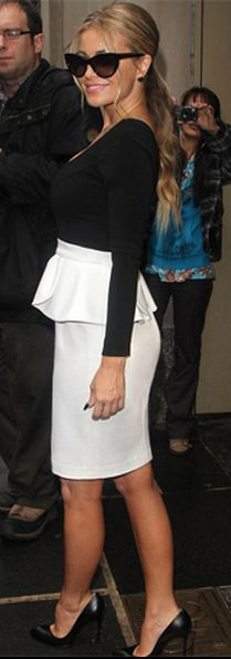 Who made  Carmen Electra's black pumps, white peplum skirt, black top, and black cat sunglasses that she wore in New York?