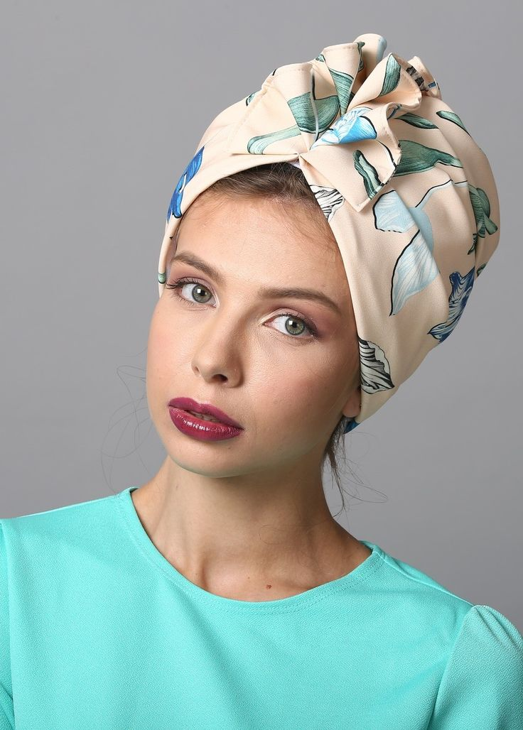 MATERIAL: spandex CARE: hand wash ready-to-wear Elegant fan-top turban in turqouise print. Great for evening-wear or special events. The turban is stretchy, light, and easy to wear! No tying involved, this turban is worn like a hat. Can be worn a