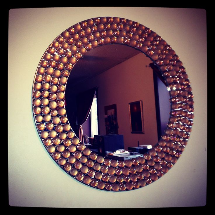 DIY decorated mirror made with dollar store flat stones :) I have made one before, and you can use any color stones you want and make different designs! the possibilities are almost endless! (: