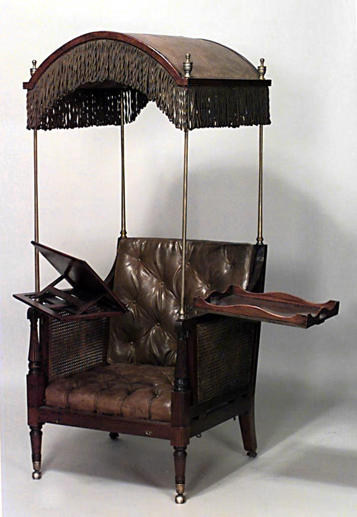 English Regency style (19th Cent) hooded mahogany library arm chair with adjustable chaise attachment and leather cushion . And, a tray for refreshments