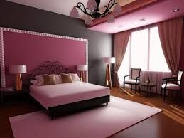 unity of colour (pink, black, wood) + symmetry (bed, bedside tables w lamps, rug, overhead lamp) + contrast + repetition of colour