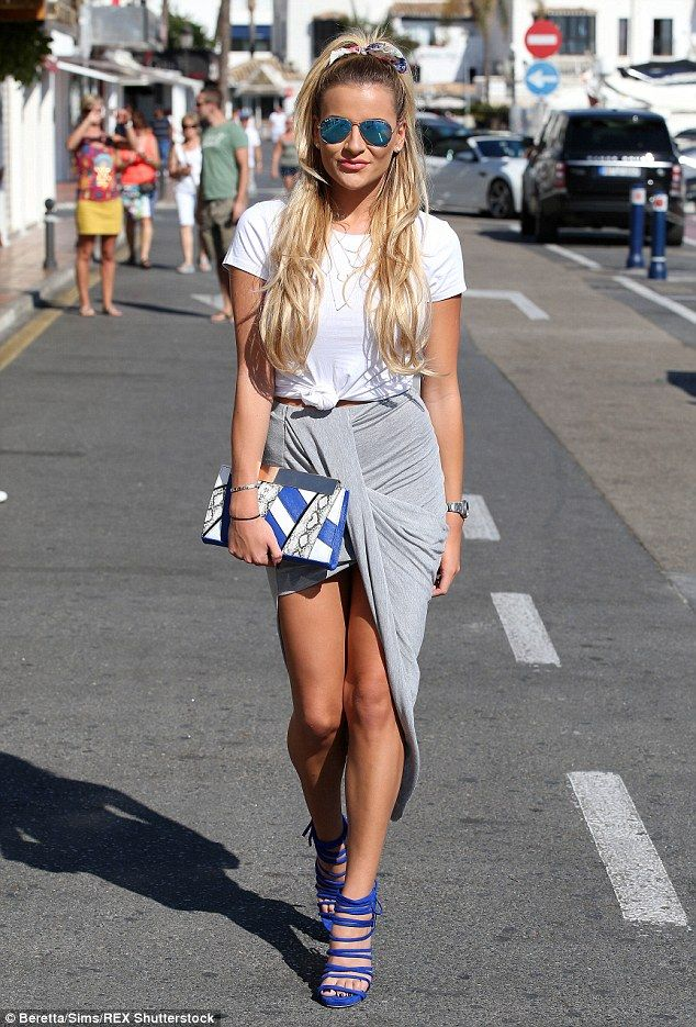 Showing some skin: Georgia slipped into a grey asymmetric skirt which exposed almost the f...