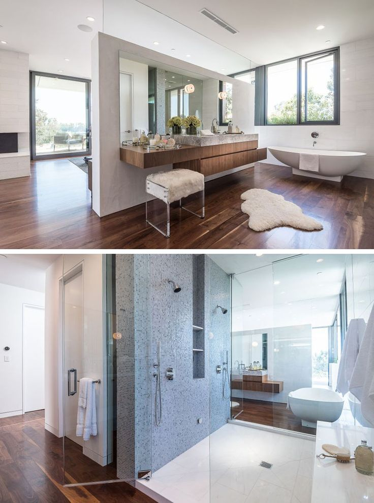 This master bathroom, with dual showers and standalone bathtub, is tucked away behind a partition wall behind the bed.