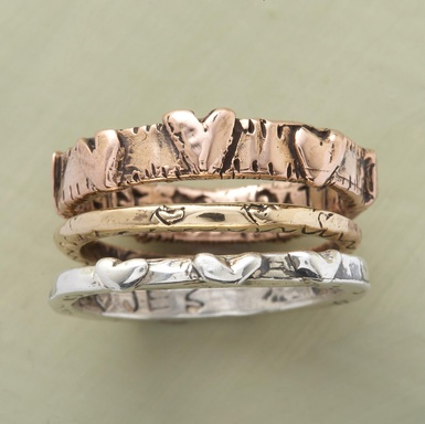 "Jes MaHarry handcrafts bands of sterling silver, 14kt yellow gold and 14kt rose gold, dotted with hearts and engraved with a reminder to ""live a life of love."" Made in the USA and signed by the artist. Exclusive. Whole sizes 5 to 9. Set of 3."