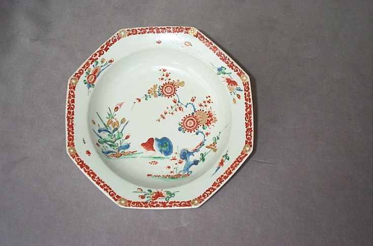 """A fine Bow soup plate of hexagonal shape with a gilt and brick red botder and painted to the centre with the      """" Two Quail """" pattern  Unmarked  Circa 1760   Width 8 3/4"""""""