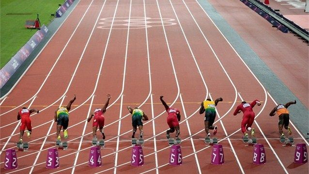 Runners leave the starters blocks to start the men's 100m final