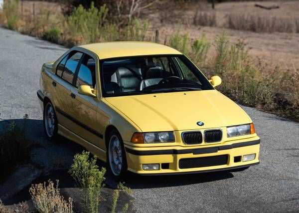 """This 1997 BMW M3 is said to be one of only five known 5-speed equipped Dakar Yellow sedans with factory sunroof delete in the US. Mileage is kind of high at 205k, but the seller describes a well cared for car with typical E36 faults such as the coolant system already sorted, adding """"there is no"""