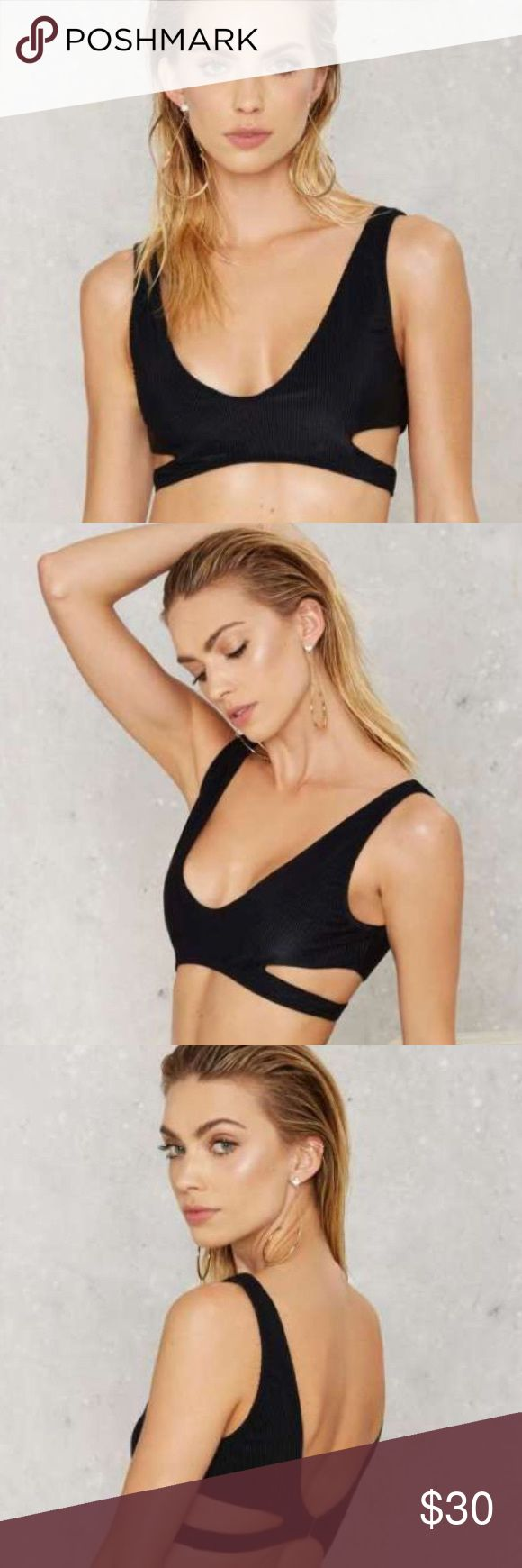 HP 10/22 Nasty Gal Cut Out Bikini Top SZ XS Gorgeous Nasty Gal black cut out bikini top! Worn ONE TIME! This black bikini top has a plunging neckline, open back design, cut-out detailing at sides lining at bust, and silver hook closure at back. SIZE XS. *Nylon/Spandex/Micronylon  *Runs true to size  *Hand wash cold  *Made in U.S.A. Nasty Gal Swim Bikinis