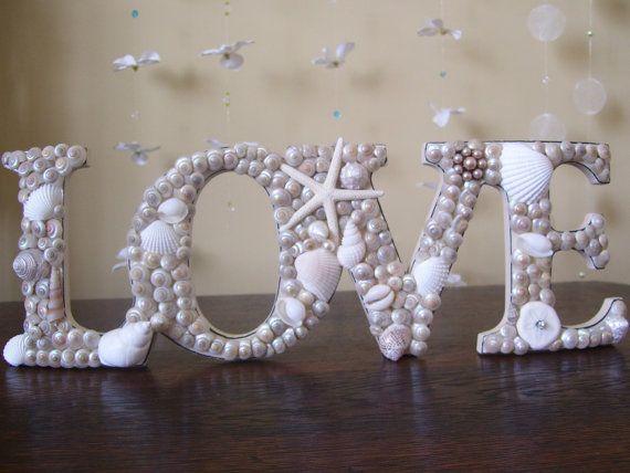 Seashell covered Love Sign Beach Wedding Decor by justbeachydecor