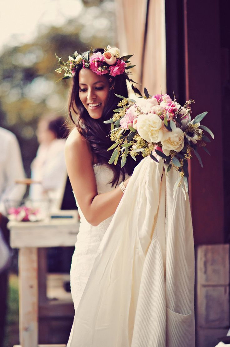 The gorgeous bride with her floral wreath and bouquet