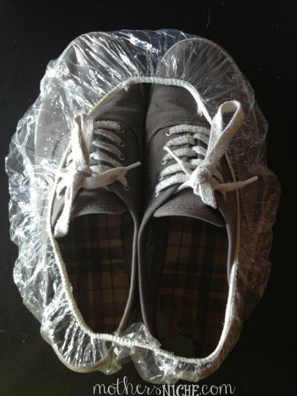 Cover your shoes with a shower cap so that they don't get other things in your bag dirty. You can get them at the dollar store, and you can also get them on Amazon for pennies each.