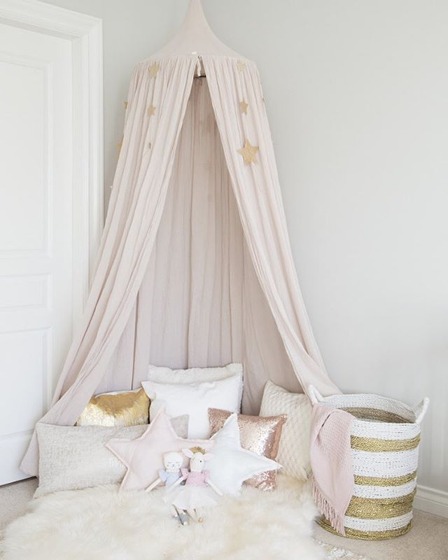 This canopy would make any little girl feel like a princess! And this little girl's #bedroom is fit for a queen! | Photography + Design: @winterdaisykids | Canopy: @numero74_official | Star Pillows: @winterdaisykids
