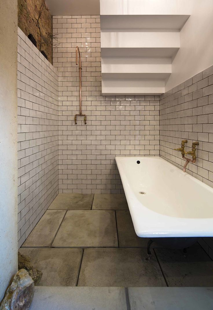 dwell bathroom ideas in the bathroom beneath the stairs copper fixtures and subway tile feel at once sensitive