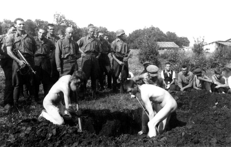 Axis Hungarian soldiers force Russian civilians in the small village of Polnikovo to dig their own graves before being summarily executed as other villagers are forced to watch the proceedings. Days previously, two Hungarian soldiers were killed in...