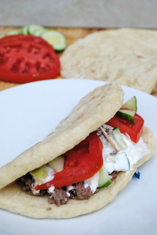Simple Ground Beef Gyros.  Spiced ground beef, tomatoes, cucumbers, and homemade tzatziki sauce. - We Got Real
