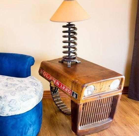 Tractor hood table with spring lamp.