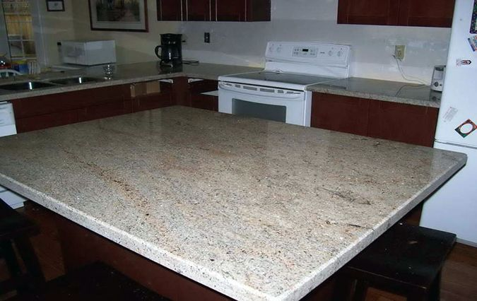 Best Ivory Fantasy Granite With Cherry Cabinets Oak Cabinets 400 x 300