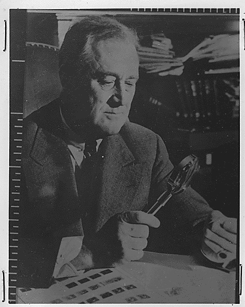 Franklin D. Roosevelt with his stamp collection in Washington, 1940