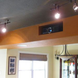 Creative hidden projector installation for a home theater or man cave. http://www.projectorpeople.com/home-theater/professional.asp