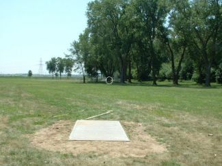 Aspen Park disc golf (good for beginners, says 'dgcoursereview.com'.  Local Omaha Directions: From Omaha, I-80 exit at 60th Street (exit 450), south 2 1/4 miles to Harrison, east 1/2 mile to 52nd Street, south 1/2 mile all the way to the end of 52nd Street (Aspen Dr.), then west around the turns into Aspen Park all the way to the parking lot. Course is to the north of the swimming pool. Tee #1 by the green pavilion.