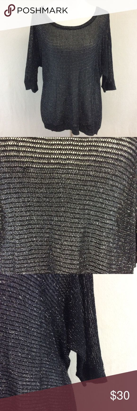 """1X TORRID black shimmering knit sweater Brand: Torrid  Style: scoop neck sweater  Size: 1X Approximate Measurements: pit to pit 21.5"""" shoulder to hem 27"""" Material: 90% rayon 6% polyester 4% metallic Features: shimmering effect, short dolman sleeves  Condition: excellent condition torrid Sweaters"""