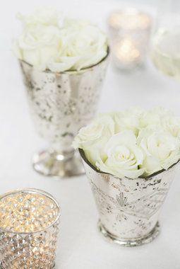 Blomster i hvitt er også lekkert til konfirmasjonbordet.