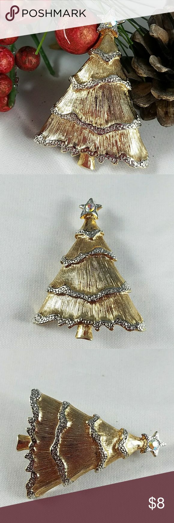 🎅JC Christmas Goldtone Tree Pin Christmas tree pin, goldtoned with some silvertone on bottom of branches and a clear stone on top/tip of tree. Great used condition. Light surface scratches. Marked LC. Jewelry Brooches