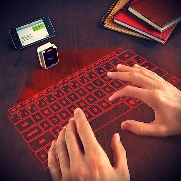 Laser Projected Keyboard - Futuristic style laser projection virtual keyboard that lets you type whenever you need it. It's portable, sleek, sturdy and practical.