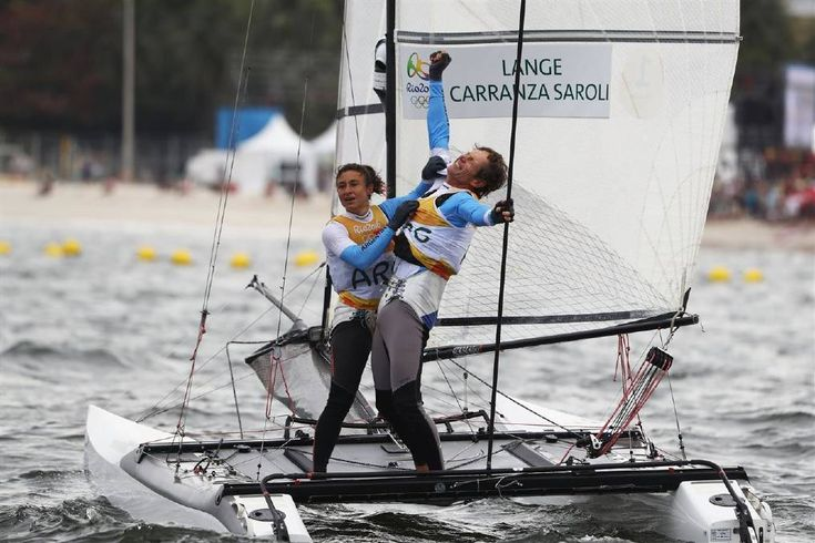 Santiago Lange of Argentina and Cecilia Carranza Saroli of Argentina celebrate winning the gold medal in the Nacra 17 Mixed class on Day 11 of the Rio 2016 Olympic Games at the Marina da Gloria on August 16, 2016 in Rio de Janeiro, Brazil. Photo: Clive Mason/Getty Images