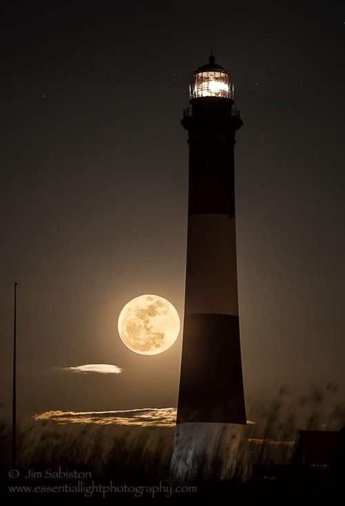 Gorgeous view of a #lighthouse bathing in the light of a full moon! http://livingpierside.tumblr.com/