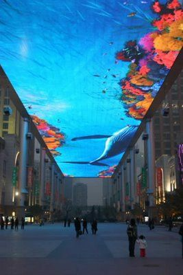 World's Largest Virtual Fish Tank, 30 by 250 meters LED screen or 32 million dollar Virtual Aquarium mounted at about 80 feet in the air between two shopping malls in Beijing.