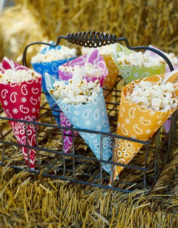 What a fun, super easy to do idea: Popcorn served up in brightly hued bandannas. #party #picnic #food #snacks #popcorn #bandanna #country #farm
