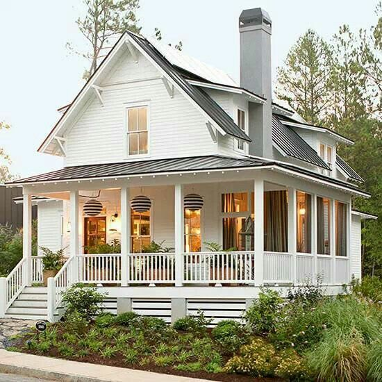 A wrap around porch makes the house look bigger