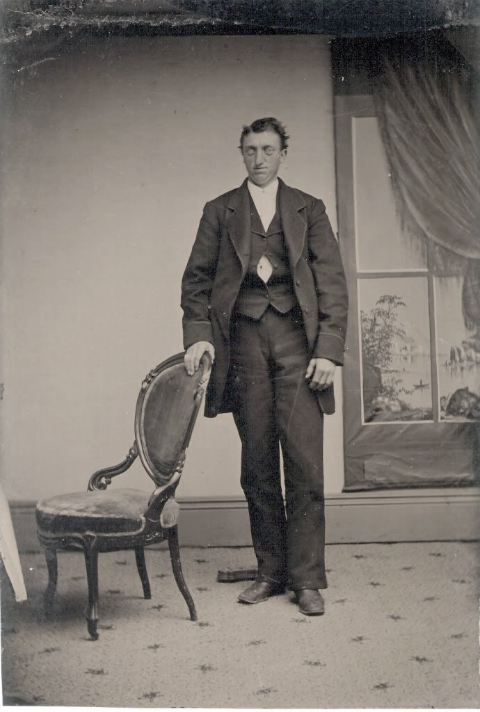 Victorian post-mortem photography. They held bodies on stands to pose them.