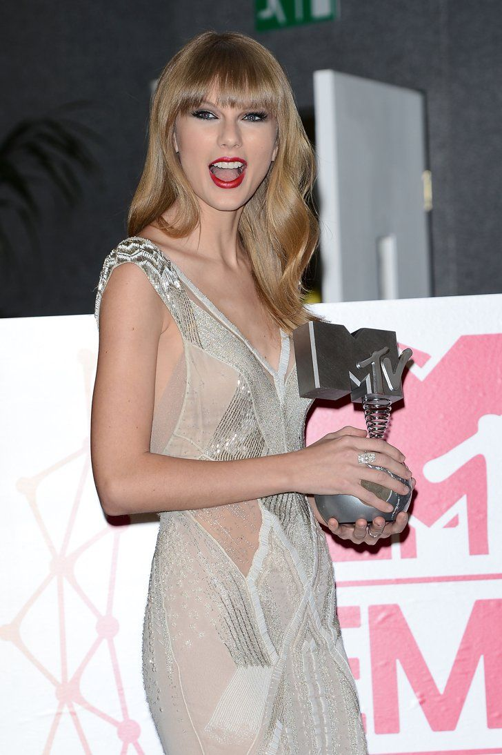 Pin for Later: Surprise — It's Taylor Swift's Birthday!  She posed backstage with her MTV EMA trophy in November 2012.