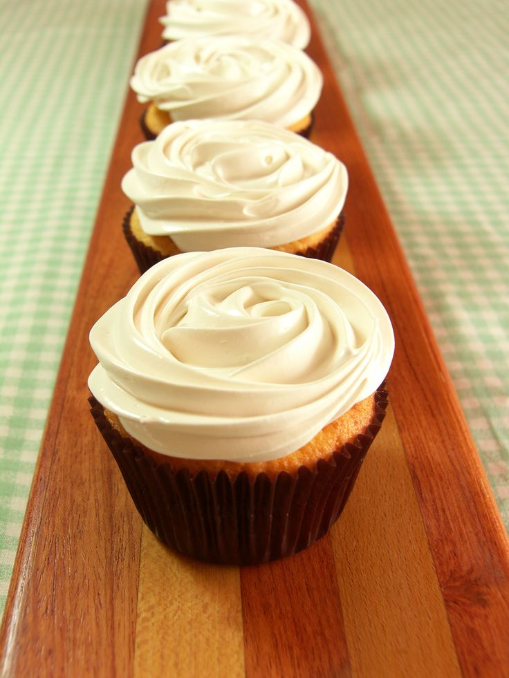 Soft vanilla cupcakes. Velvety lemon curd. Fluffy marshmallow frosting. Three of my favorite things wrapped into one awesome little cupcake. I love filled cupcakes. Biting into one of these lusciou…