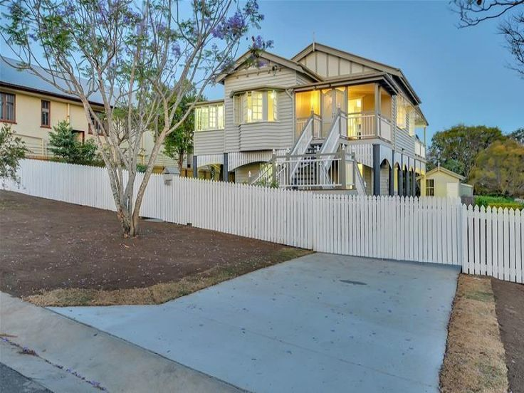 Hertiage Listed Queenslander.  House lift & full renovation.  Feature timber stumps & battens on the front and side are all new and compliment the period.    Front deck was opened back up with batwing doors and new stairs adding to the front facade.
