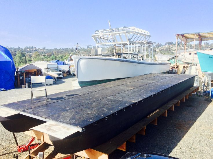 "Done with the subfloor. 3/4"" pressure treated plywood with ""hot mopped"" roofing asphalt on top. Should be waterproof for a thousand years!  Www.sandiegopontoon.com  San Diego Pontoon Boat Rental"