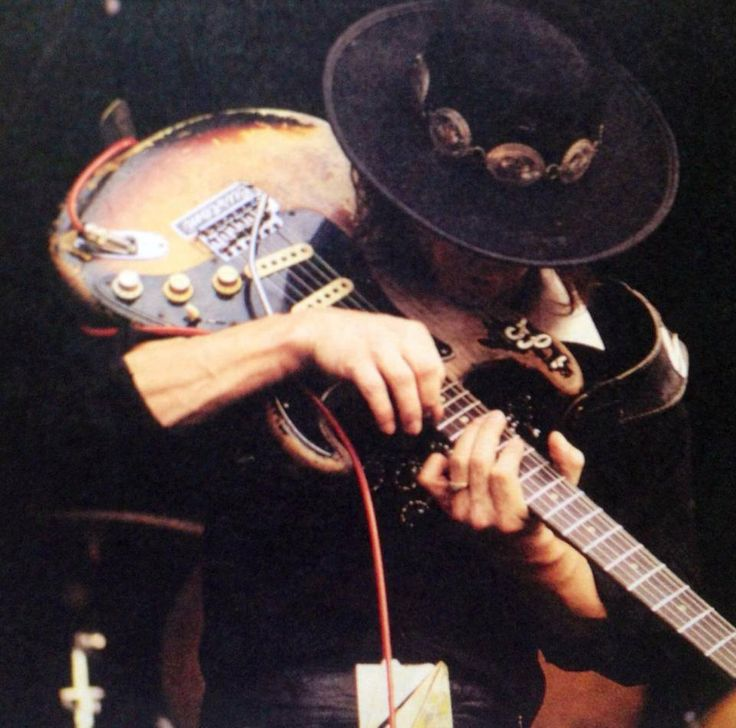 Stevie Ray Vaughan playing guitar in the usual way.